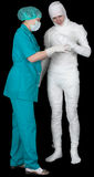 Man in bandage and nurse Royalty Free Stock Photos