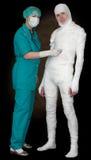 Man in bandage and nurse with stethoscope Stock Image
