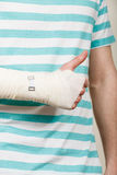 Man with bandaged hand showing thumb up. Royalty Free Stock Photo