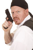 Man bandana on head gun close look mad. A man in a bandana is mad with a gun Stock Photography