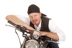 Man bandana motorcycle arms on handlebars Royalty Free Stock Photo
