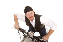 Man bandana motorcycle lean forward slight smile Stock Photography