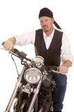 Man bandana motorcycle sit serious Stock Image