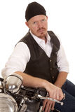 Man bandana sit on motorcycle side serious Stock Photo