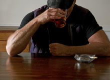 Man at a bar Stock Images