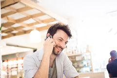 Man at the bar on the phone Stock Photos