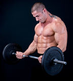Man with a bar weights in hands royalty free stock photos