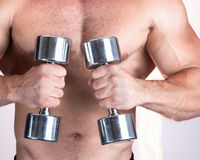 Man with a bar weights in hands training Stock Images