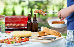 Man during barbecue in a garden Stock Images