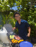 Man barbecuing in his garden Stock Image