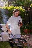 Man barbecuing Stock Photography