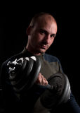 Man with barbell Stock Images