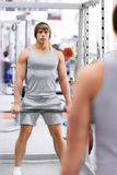 Man with a barbell Stock Photos