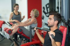 Man with barbells in gym. Man Stock Photography