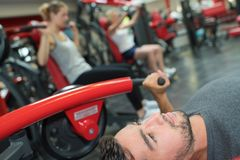 Man with barbells in gym. Gym stock image