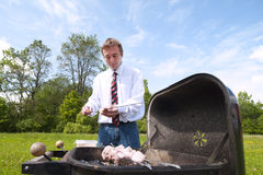 Man and barbeque. Royalty Free Stock Images