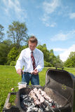 Man and barbeque. Stock Photo