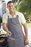 Man Barbequing In A Garden Stock Photography