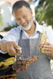 Man Barbequing In A Garden Royalty Free Stock Photography