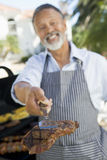 Man Barbequing In A Garden Royalty Free Stock Images