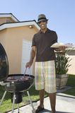Man Barbequing In Lawn Royalty Free Stock Photos