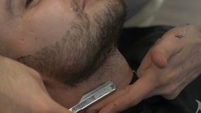 The man barber beard dub to the client stock footage