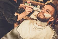 Man in a barber shop Royalty Free Stock Photos