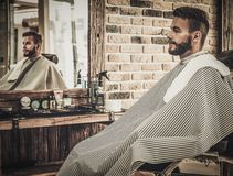 Man in a barber shop Royalty Free Stock Images