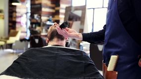 Man and barber with trimmer trimming beard at shop stock video footage