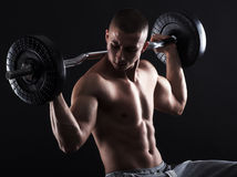 Man with bare chest lift weights Stock Image