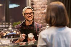 Man or barman with coffee cup and customer at cafe Royalty Free Stock Photo