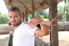 Man by a barn. Farmer working on his grounds Stock Image