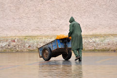 Man with barrow in Essaouria. Morocco Africa stock photography