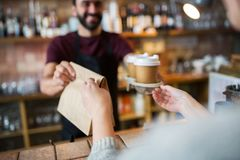 Man or bartender serving customer at coffee shop Royalty Free Stock Photos