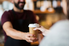 Man or bartender serving customer at coffee shop Royalty Free Stock Photo