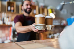 Man or bartender serving customer at coffee shop Royalty Free Stock Images