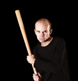 Man with  baseball bat on black Royalty Free Stock Images