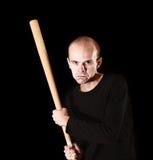 Man with  baseball bat on black. Background Royalty Free Stock Images