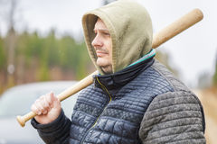 Man with a baseball bat near car Royalty Free Stock Photo