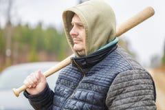 Man with a baseball bat near car Royalty Free Stock Photo