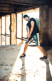 Man with baseball bat on the ruins Stock Images
