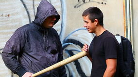 Man with a baseball bat talking with teenager stock video footage