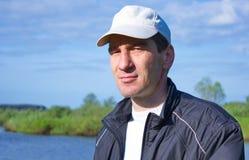 Man in a baseball cap Stock Image