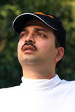 Man in baseball cap  Stock Images
