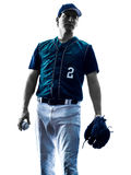 Man baseball player silhouette isolated. One caucasian man baseball player playing  in studio  silhouette isolated on white background Royalty Free Stock Images