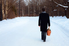 A man with a basket. In winter park preparing surprise to somebody Royalty Free Stock Photo