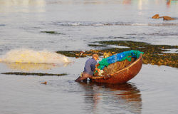 A man with basket boat on beach in Phan Thiet, Vietnam Royalty Free Stock Photography