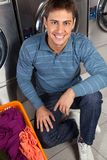 Man With Basket Of Clothes At Laundry Stock Photo