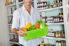 Man With Basket Of Fresh Vegetables Standing In Royalty Free Stock Image