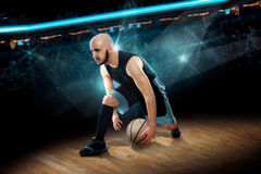 Man in basketball action game dribbles Royalty Free Stock Photography